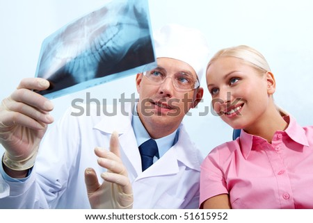 Image of dentist giving medical consulting to woman - stock photo