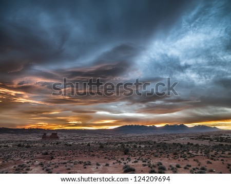 Image of deserted landscape with cloudy sky.