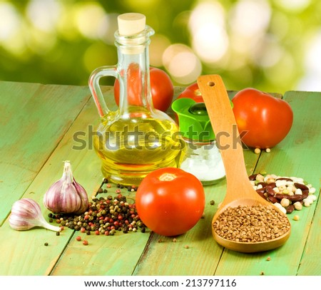 image of different ingredients for cooking on a green background closeup