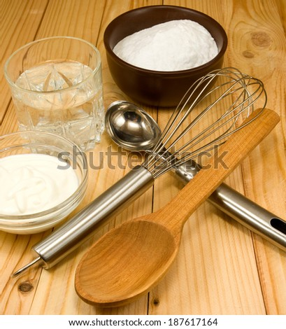image of different ingredients for cooking on a wooden table closeup
