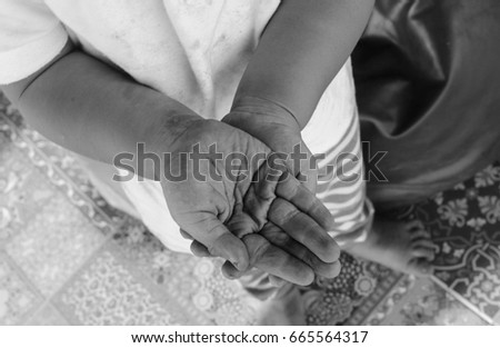 Image of dirty hand crossing over, black and white photo, need some help #665564317