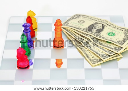 image of dollar bill on a chess board
