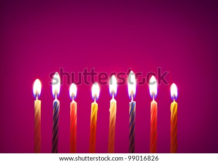 Image of eight birthday candles over purple background