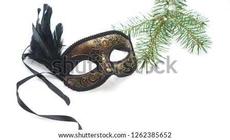Image of elegant black and gold venetian, mardi gras mask on white snow background. Vintage photo. Christmas New Year carnaval Party night conception. Venice Carnival mask, close up #1262385652