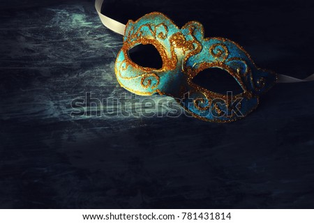 Image of elegant blue and gold venetian, mardi gras mask over black background #781431814