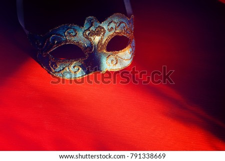 Image of elegant blue and gold venetian mask over red background #791338669