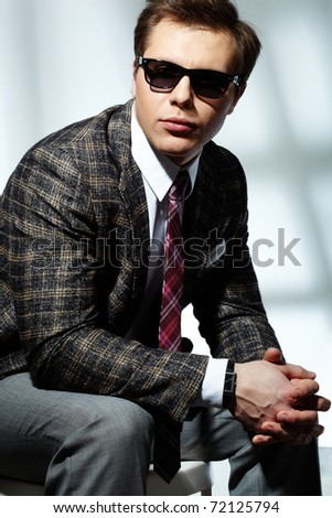 Image of elegant man posing in front of camera