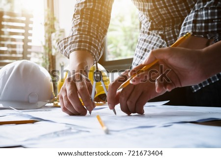 Image of engineer meeting for architectural project. working with partner and engineering tools on workplace #721673404