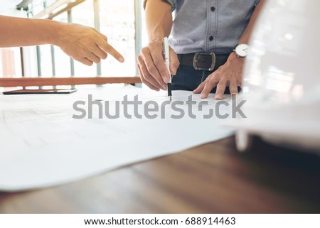 Image of engineer or architectural project, Close up of hands architects engineering working on blueprint with engineering equipment tool, Construction concept. #688914463