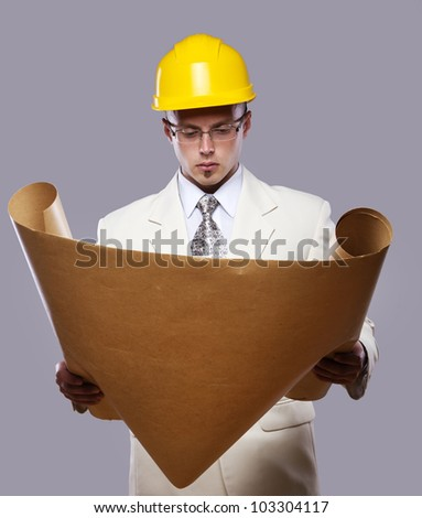 Image of engineer reading map