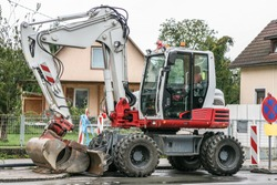 Image of excavator or bagger on the street.