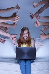 Image of excited facebook girl sitting on couch