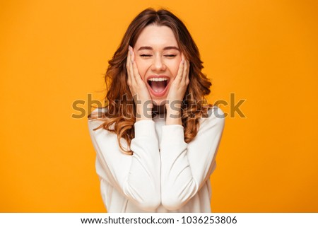 Image of excited screaming young woman standing isolated over yellow background. #1036253806