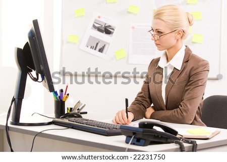 Lady Sitting at Computer Sitting Before Computer in