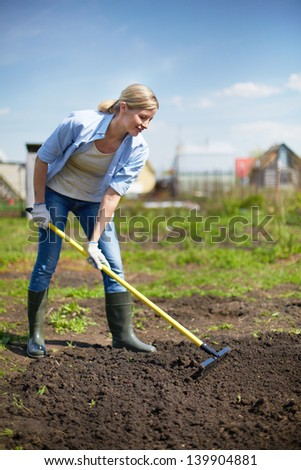Image of female farmer working in the garden