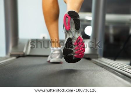 Image of female foot running on treadmill