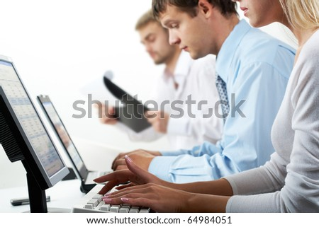 Image of female typing on keyboard in working environment