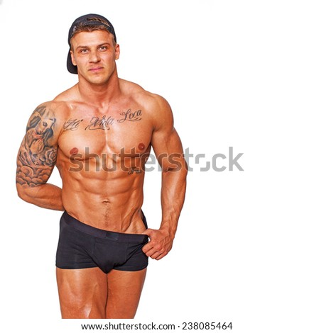Image of flitry hot guy who is hiding something in his right hand