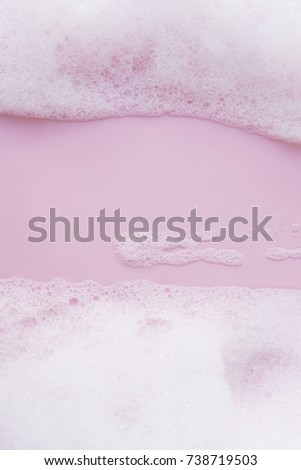 image of foam bubbles on pink background