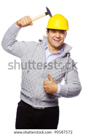 Image of foreman in hard hat and hammer