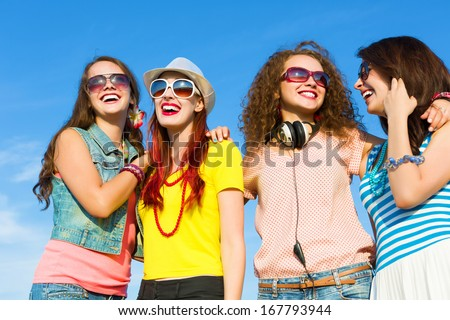 Image of four young attractive girls having fun outdoors #167793944