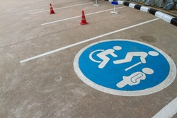Image of free space blue point of cars parking area with wheelchair or disable person-elderly people-pregnant woman sign or symbol shown on outdoor concrete floor background.