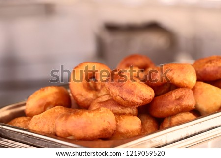 Image of freshly made donuts. The concept of food and service. Cropped shot, blurred, close-up, bokeh #1219059520