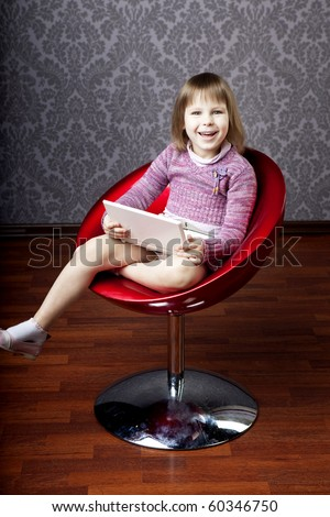 Image of girl sitting in a chair with a laptop