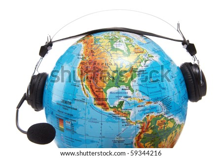 Image of globe with headset on it on white background