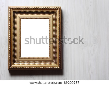 Image of golden art frame on the wall in dramatic light