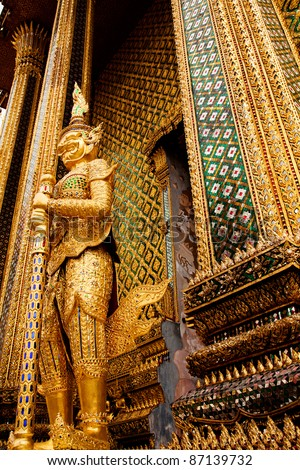 Image of golden sculpture of devil in Emerald Buddha Temple,Thailand