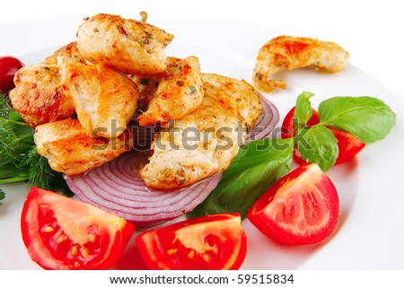 image of grilled chicken meat on white plate