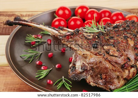 image of grilled ribs served on wooden table