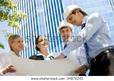 Image of group of several workers planning their work outside
