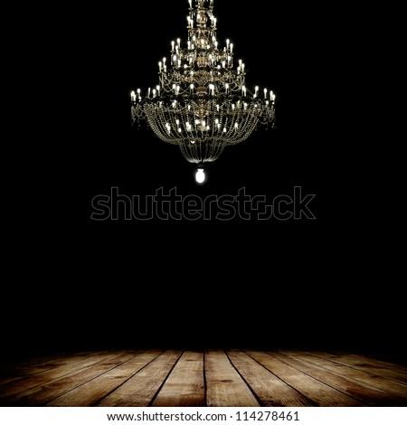 Image of grunge dark room interior with wood floor and chandelier. Background