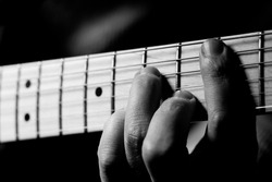 Image Of Hand And Guitar.