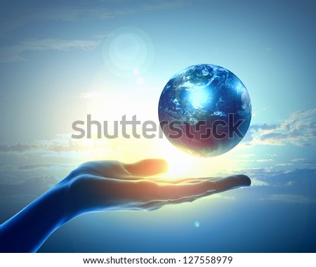 Image of hand holding earth planet against illustration background