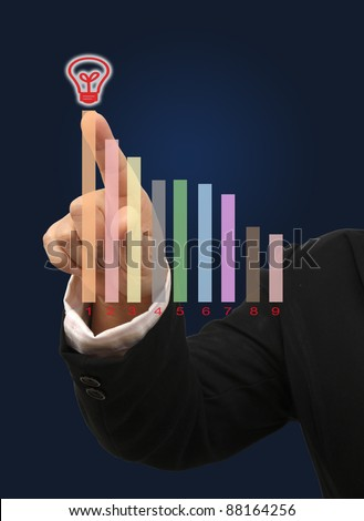 Image of hand point to highest business target and dark blue background