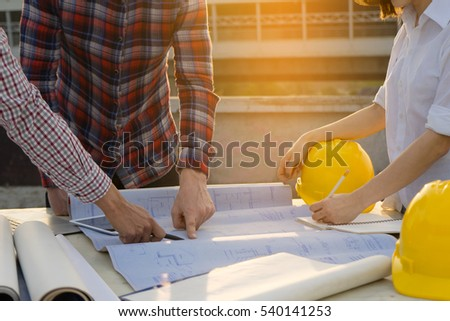 Image of Hands of architect engineer meeting for architectural project. working with partner and blueprint on table. selective focus, Teamwork Concept.