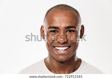 Image of handsome smiling young african man standing isolated over white background. Looking camera. #722913181