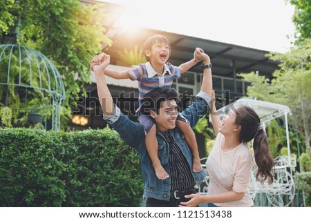 Image Of happy asian family Consisting of parents and children, Happy together for a holiday.