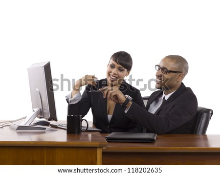 Image of happy business partners in front of computer against white background