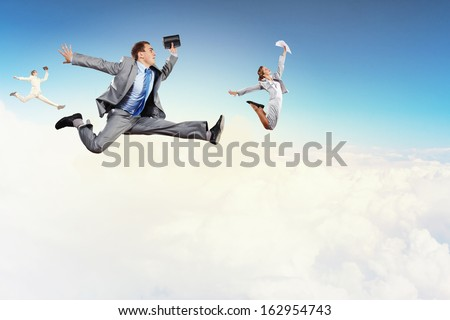 Image of happy business people jumping high in sky