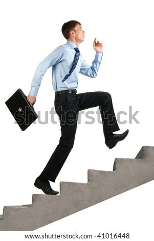 Image of happy businessman running upstairs