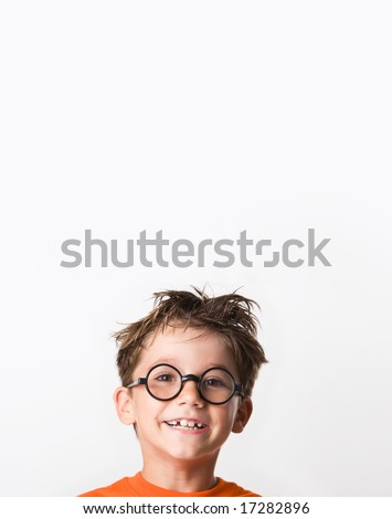 Image of happy child with tousled hair looking at camera with smile