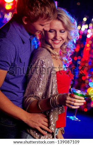 Image of happy couple in the night club