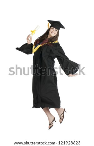 Image of happy female graduating student jumping while holding her diploma