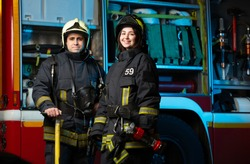 Image of happy fireman and woman near fire truck