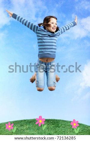 Image of happy girl jumping on the grass