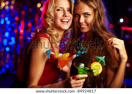 Image of happy girls looking at camera at party